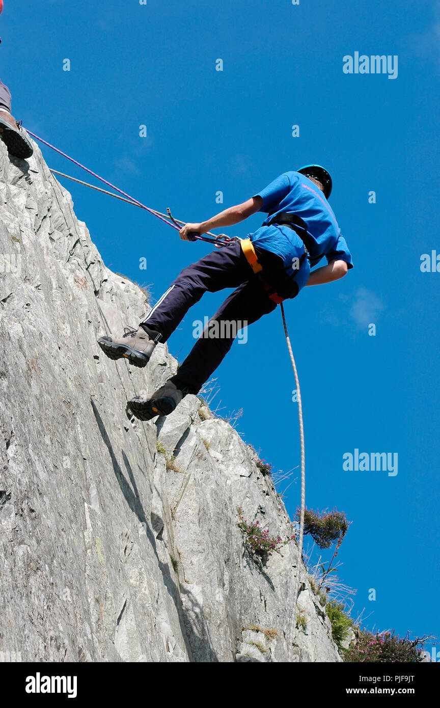 Abseiling adventure activity in the English Lake District. - Stock Image