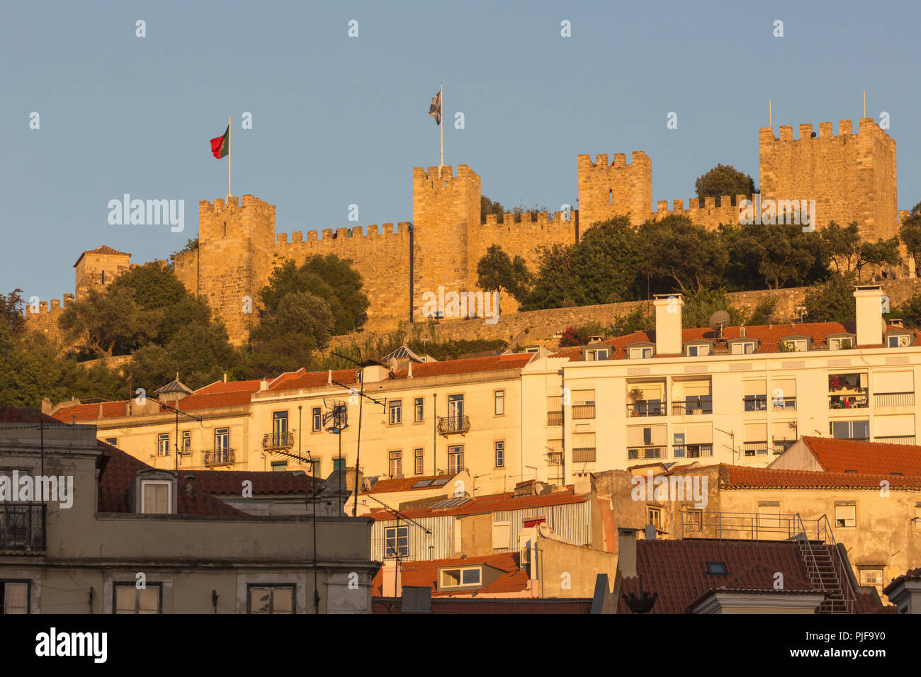 Lisbon, Portugal. Castelo de Sao Jorge seen from Praca da Figueira.  Castle of St George seen from the Figueira Square. - Stock Image