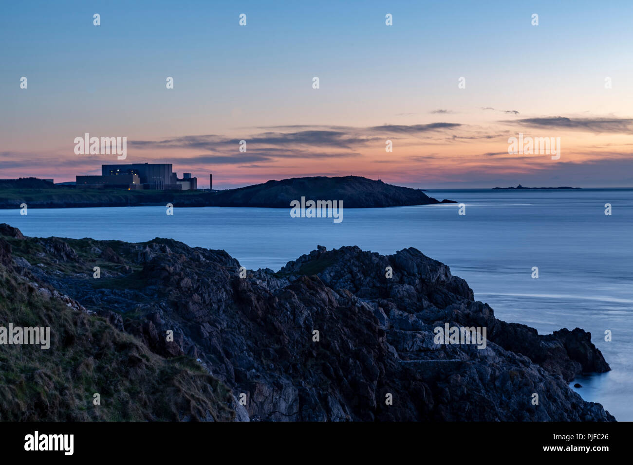 Wylfa nuclear power station at dusk, Anglesey on the North Wales coast - Stock Image