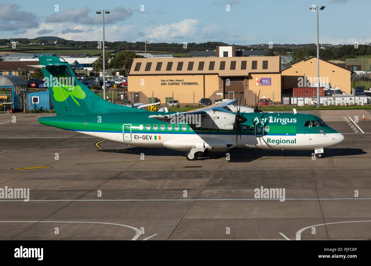 An Aer Lingus ATR-42 aeroplane, registered EI-GEV, taxying at Ronaldsway Airport on the Isle Of Man. - Stock Image