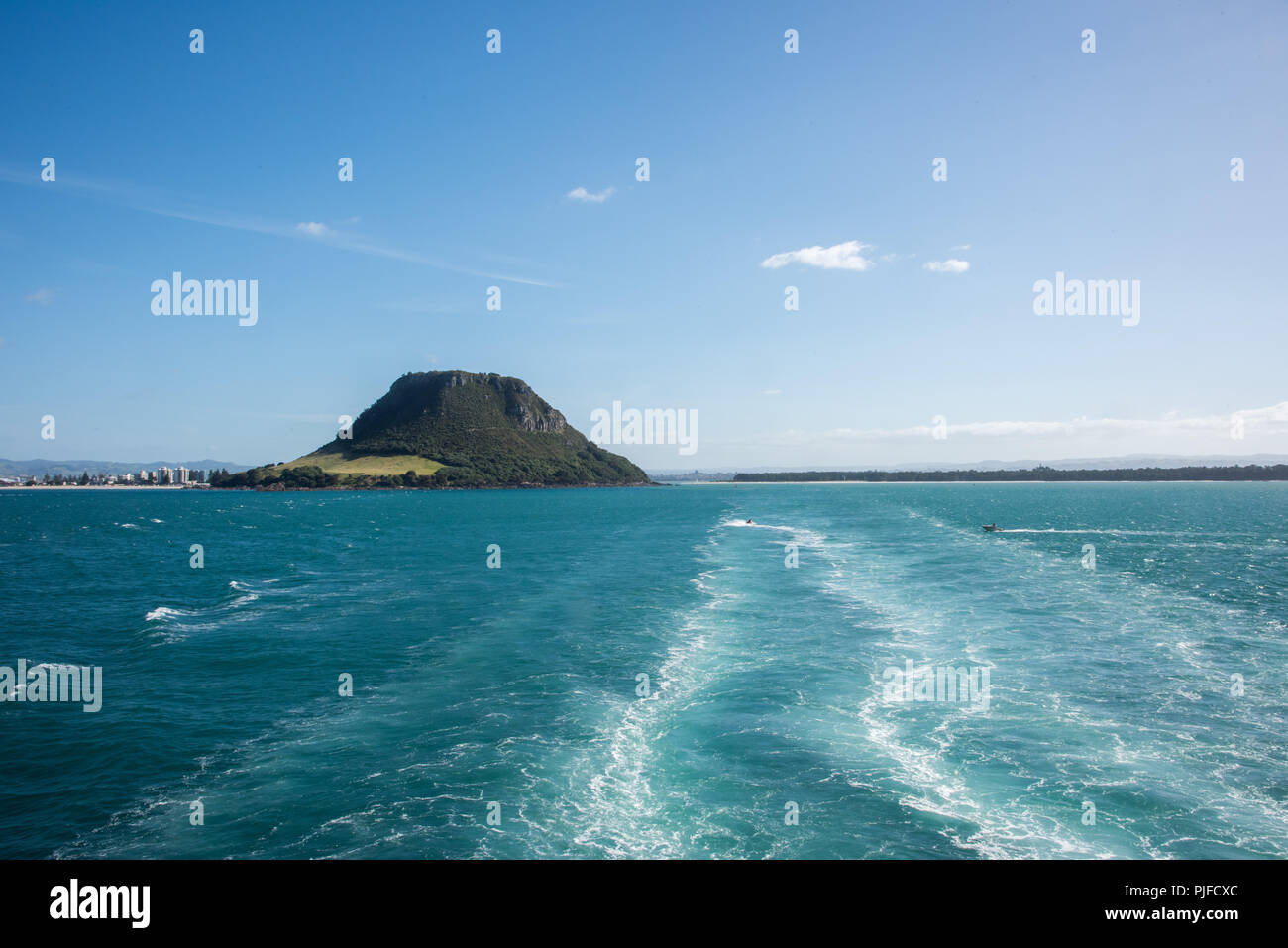 View of Mount Maunganu and the waterfront from the harbour in Tauranga, New Zealand - Stock Image