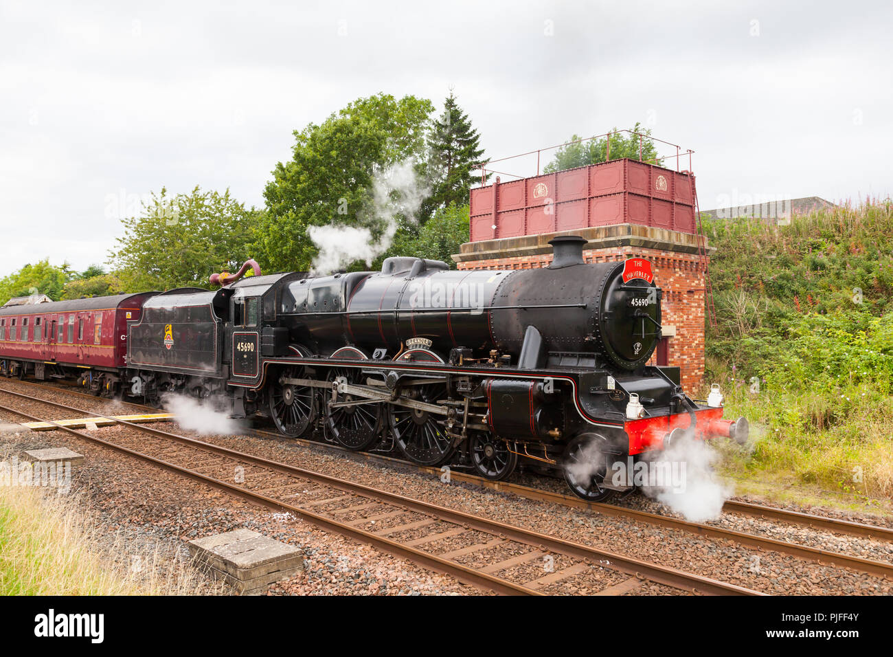 Steam train 45690, Leander, pictured at Appleby in Cumbria, England, on the Settle to Carlisle railway. - Stock Image