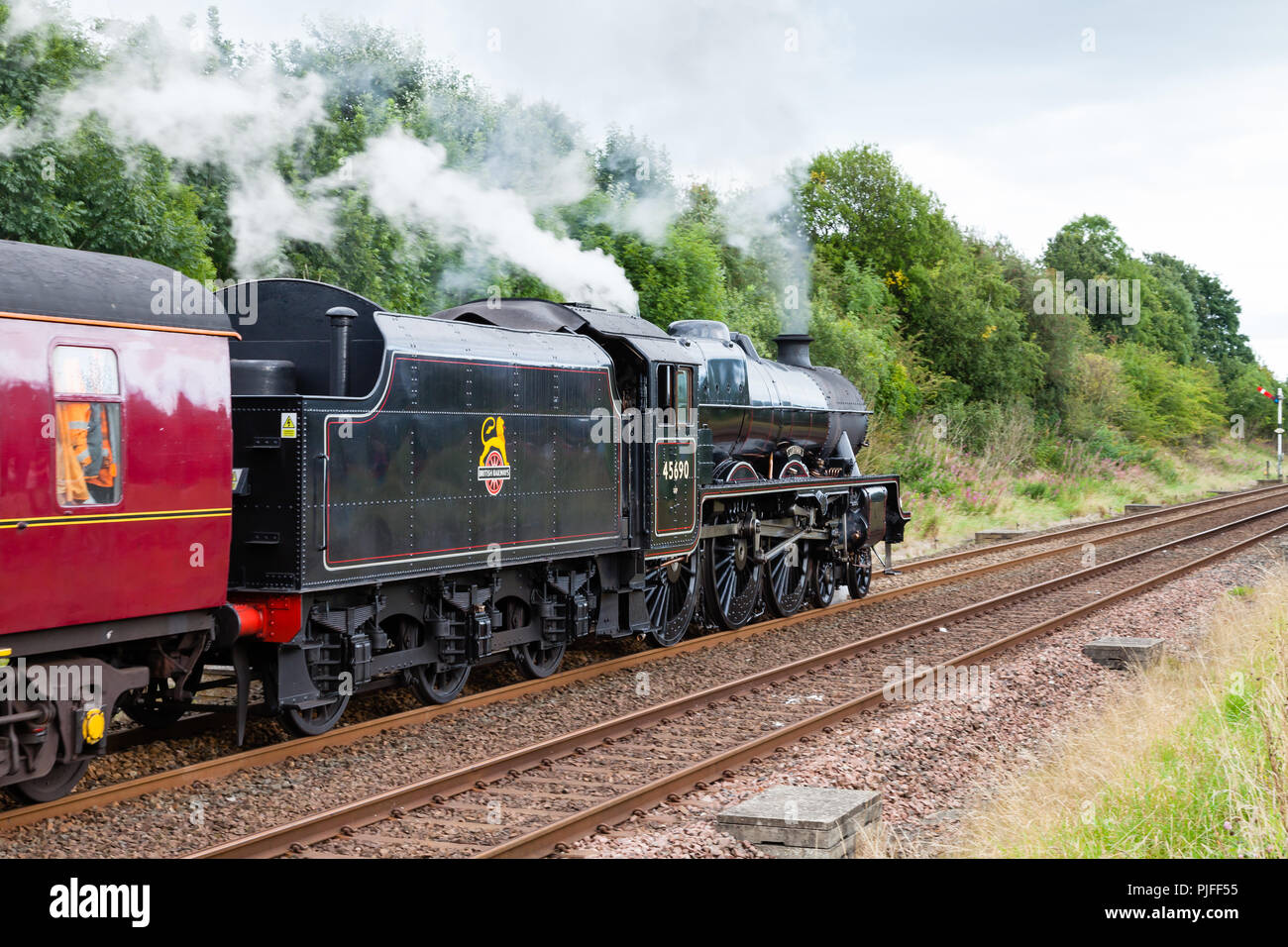 Steam train 45690, Leander departs Appleby in Cumbria, England on the Settle to Carlisle railway. - Stock Image