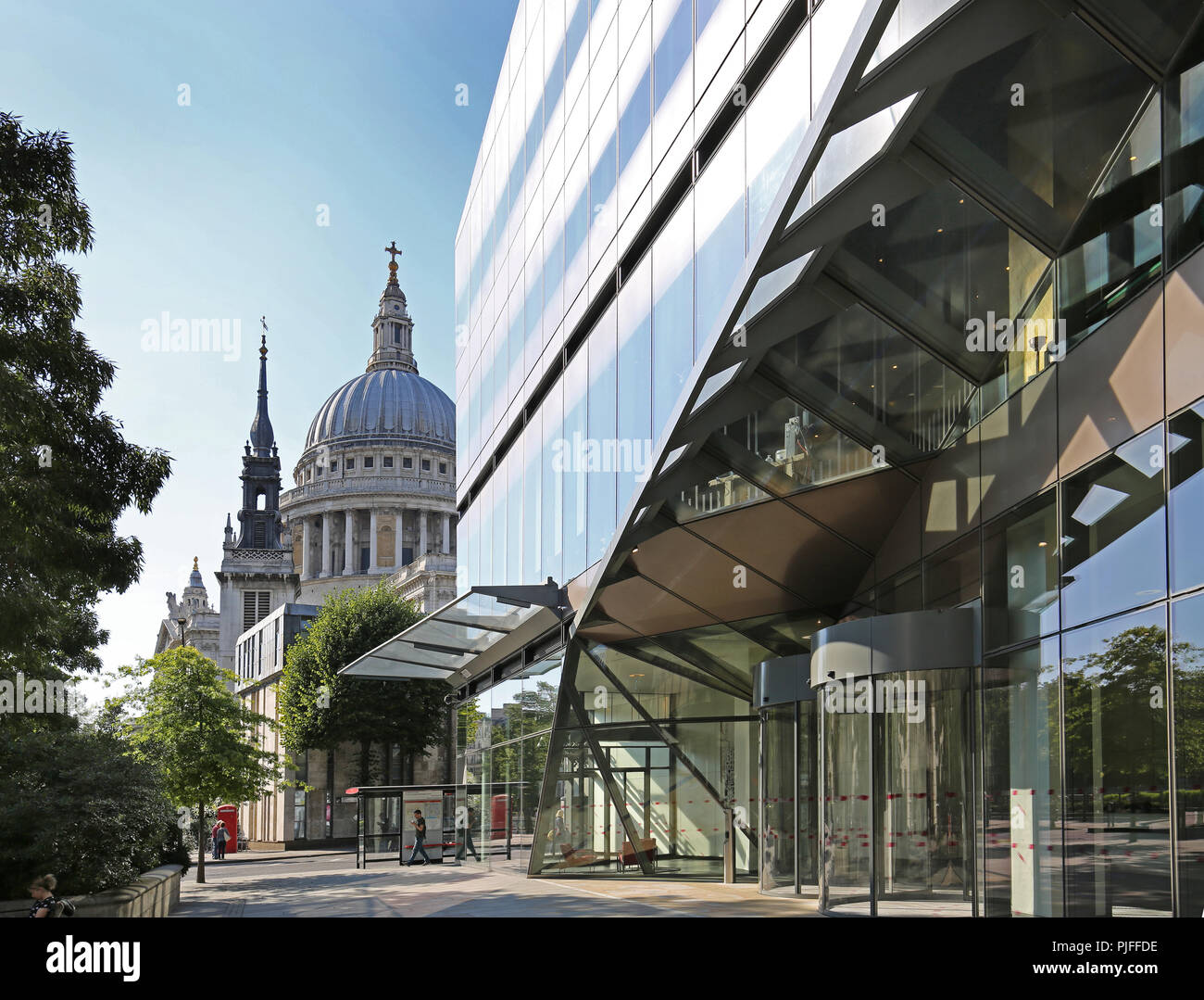 Entrance to the One New Change office development with St Pauls Cathedral beyond - contrasting the old and new. - Stock Image