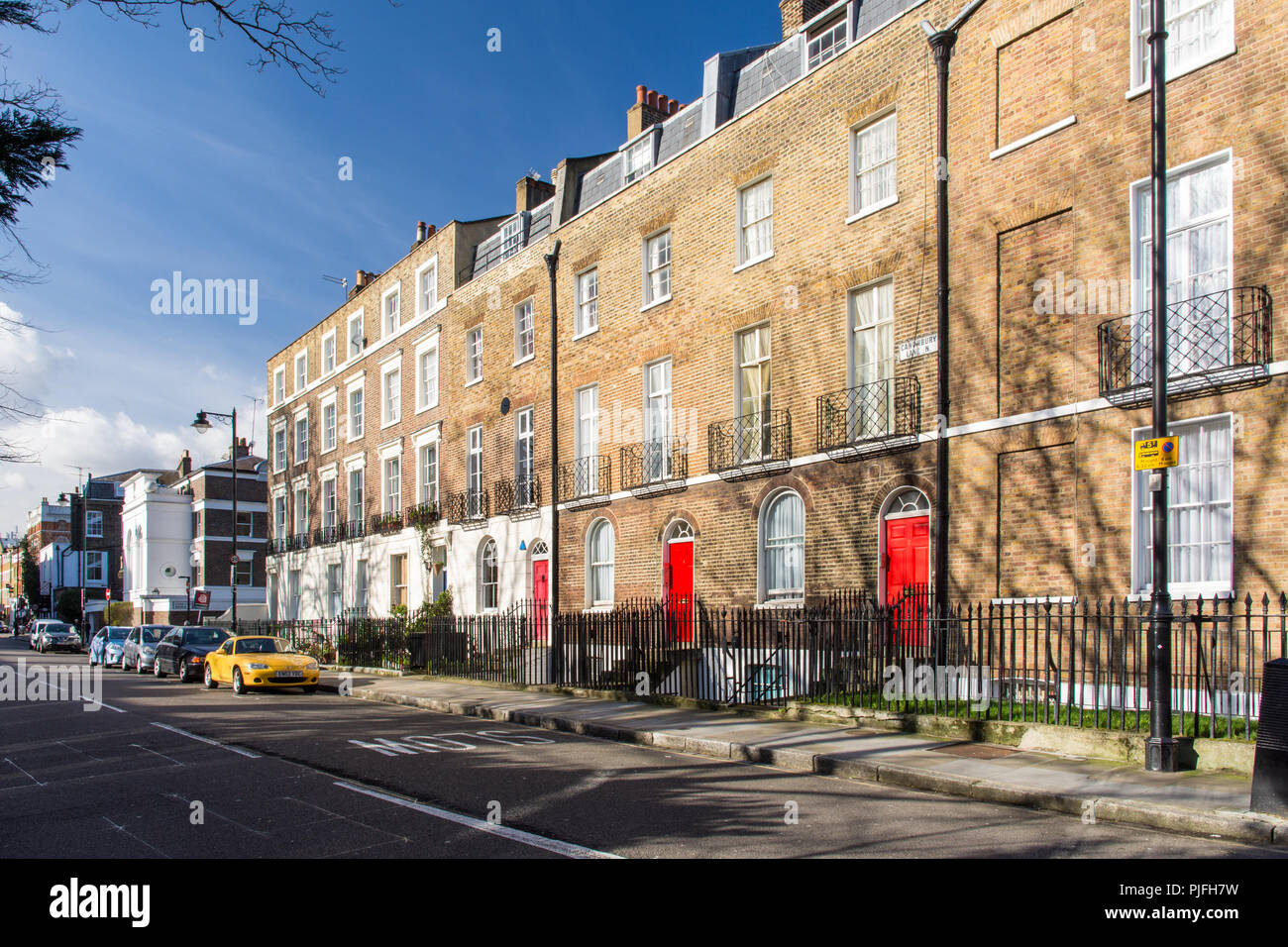 London, England, UK - February 12, 2018: Terraces of traditional town houses line residential streets in the Canonbury neighbourhood of Islington, Nor - Stock Image