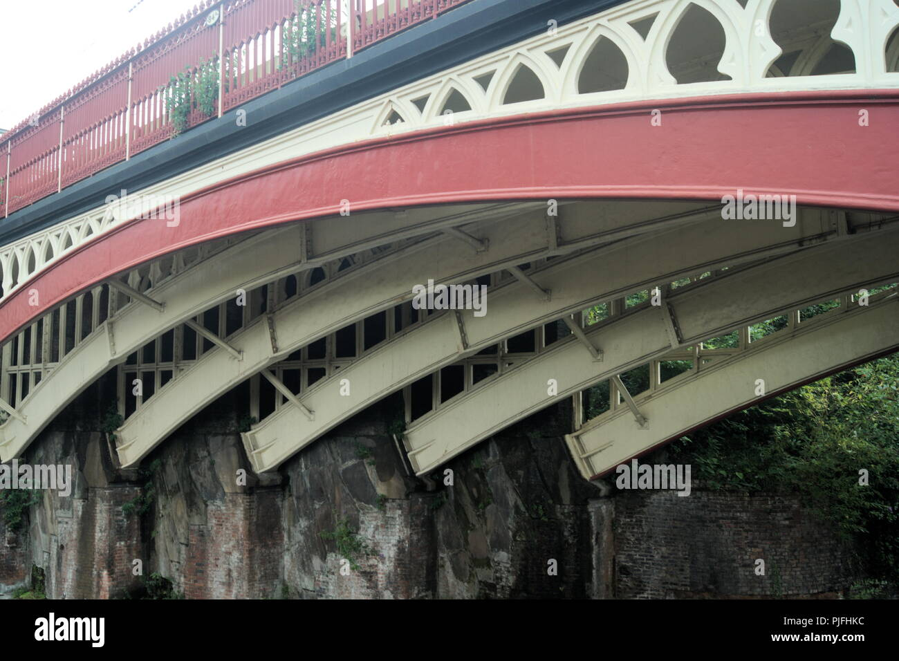 View of a cast iron railway bridge at Castlefields, Manchester, England. A close up view of the curved supports for this elegant and beautiful bridge. Stock Photo