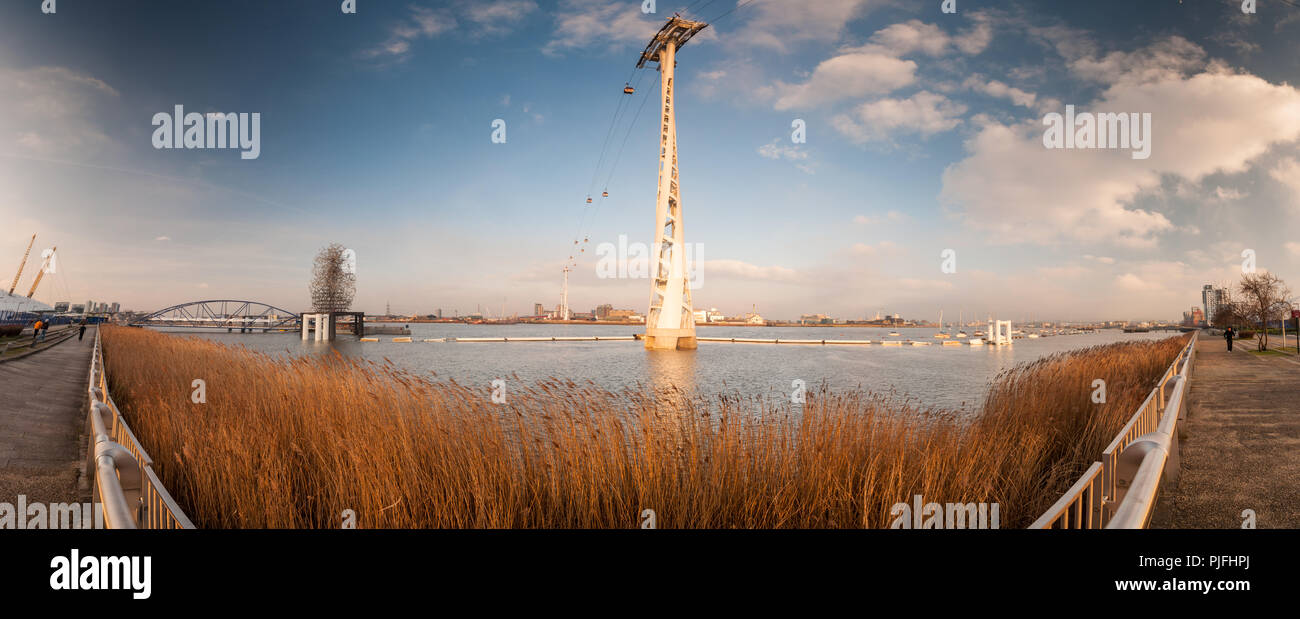 London, England, UK - February 17, 2013: The 'Emirates Air Line' cable car crosses the estuary of the River Thames between the East London boroughs of - Stock Image