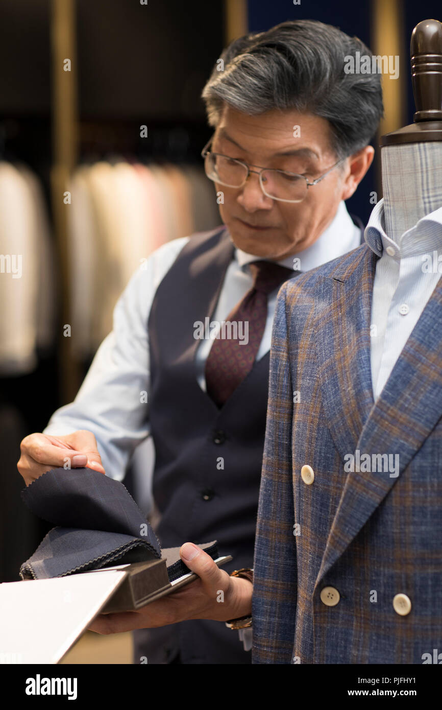 Confident fashion designer working - Stock Image