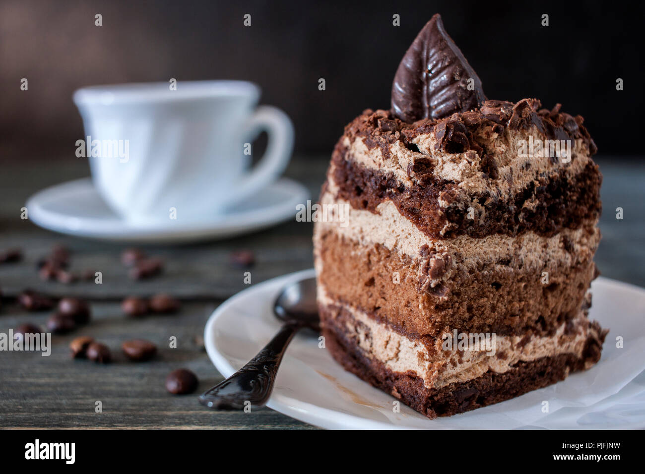 Tasty piece of chocolate cake on wooden table background Stock Photo