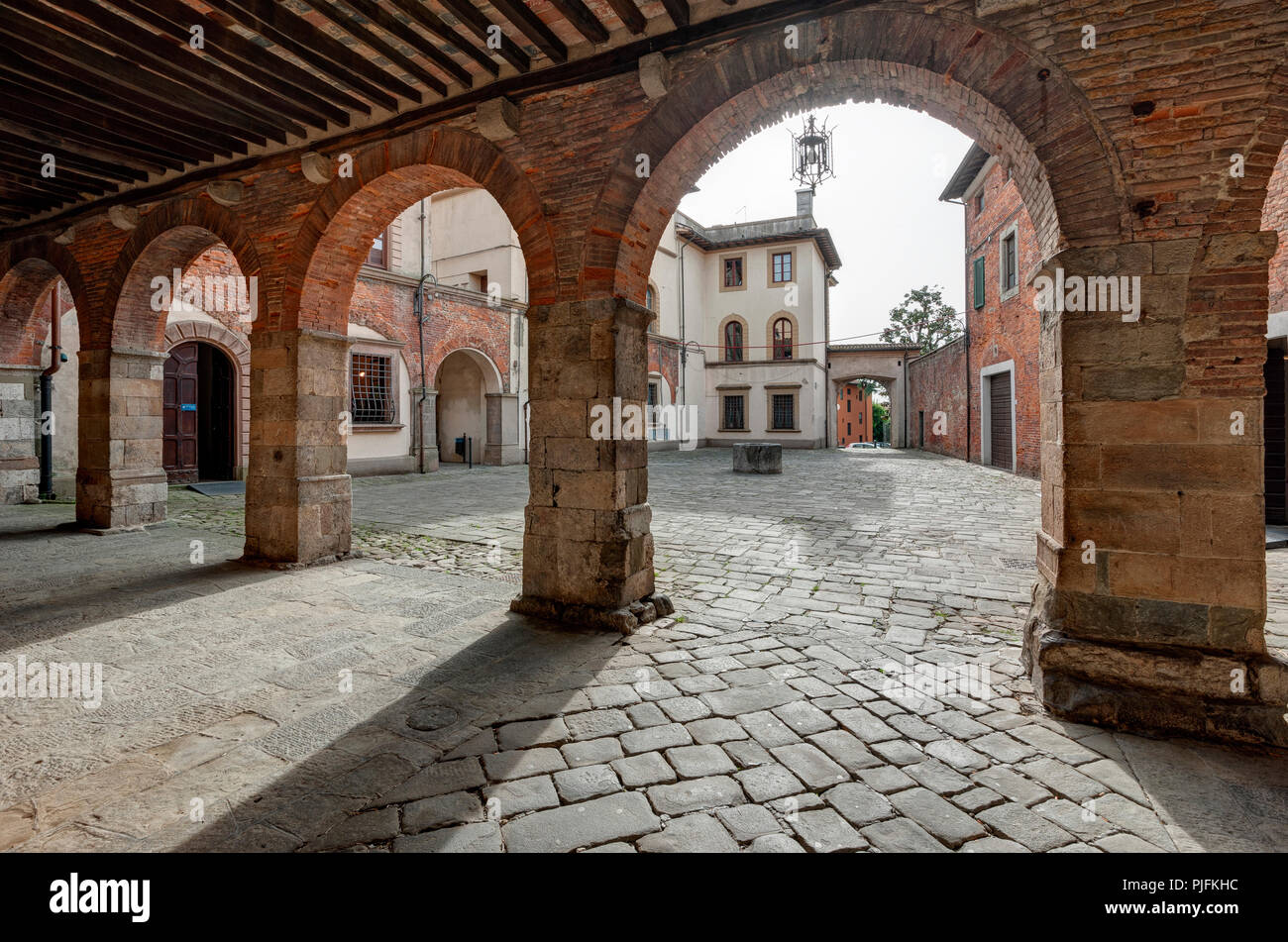 The lower loggia of Piazza Ospitalieri, in the old town of Altopascio, Lucca, Italy - Stock Image