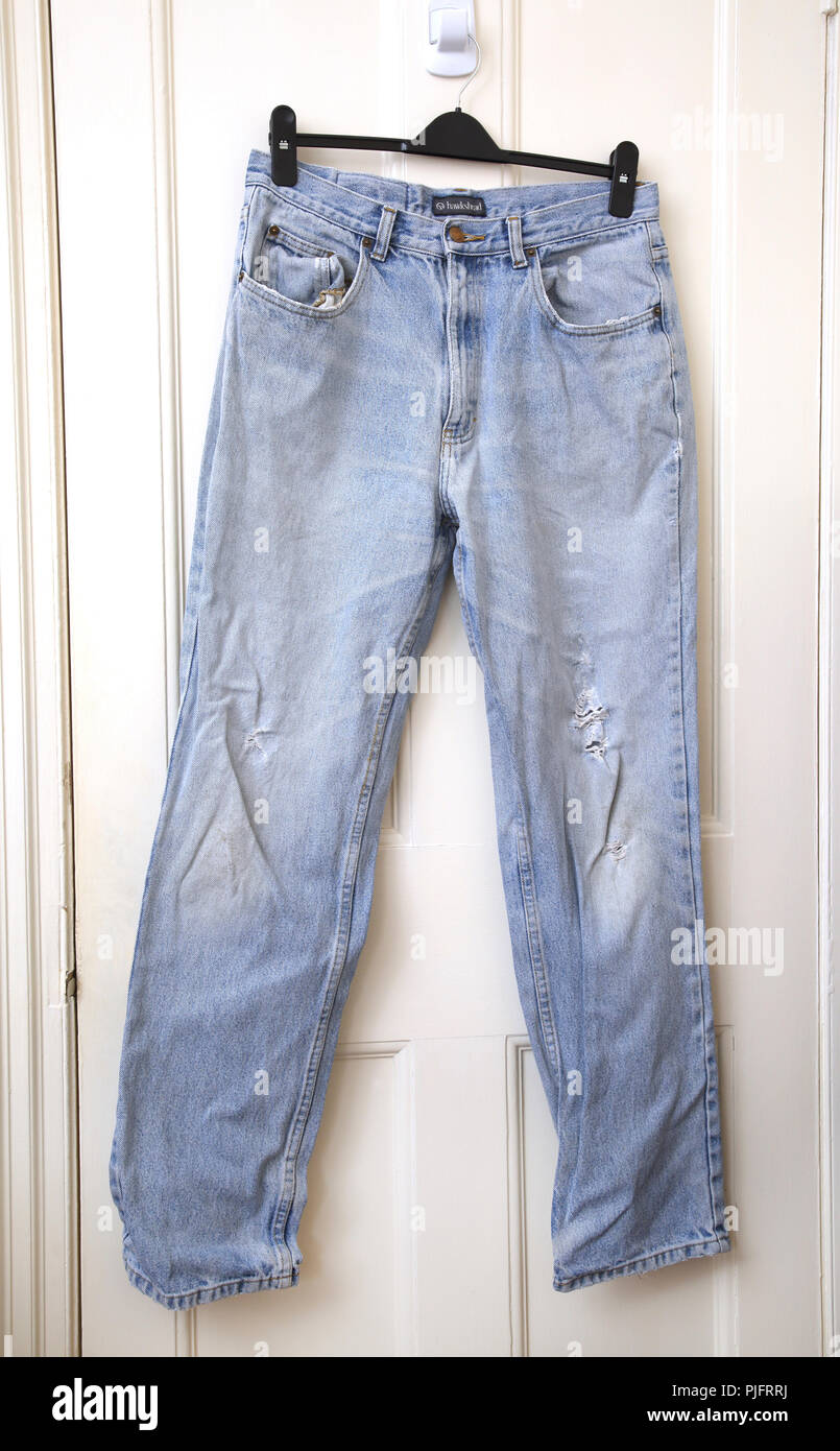 A Pair of Old Worn Out Hawkshead Blue Jeans - Stock Image