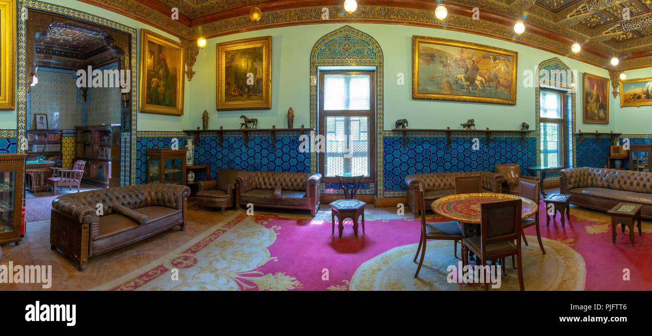 Manial Palace of Prince Mohammed Ali. Living room at the residence building with Turkish floral blue pattern ceramic tiles and vintage furniture - Stock Image