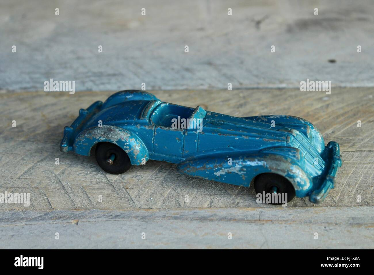 vintage blue diecast car on a wood background Stock Photo