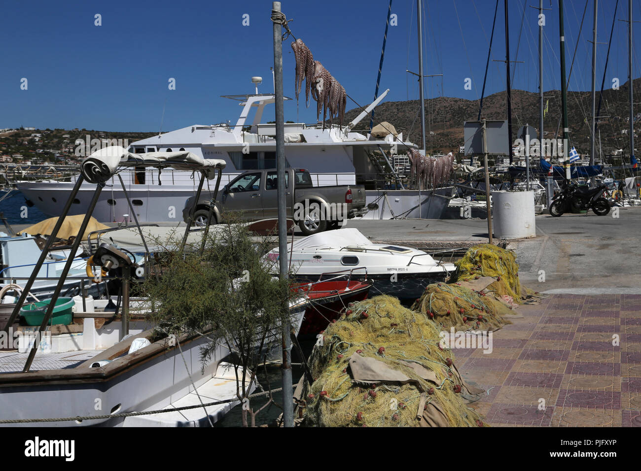 Attica Greece Porto Rafti Boats In Harbour Octopi Hanging To Dry - Stock Image