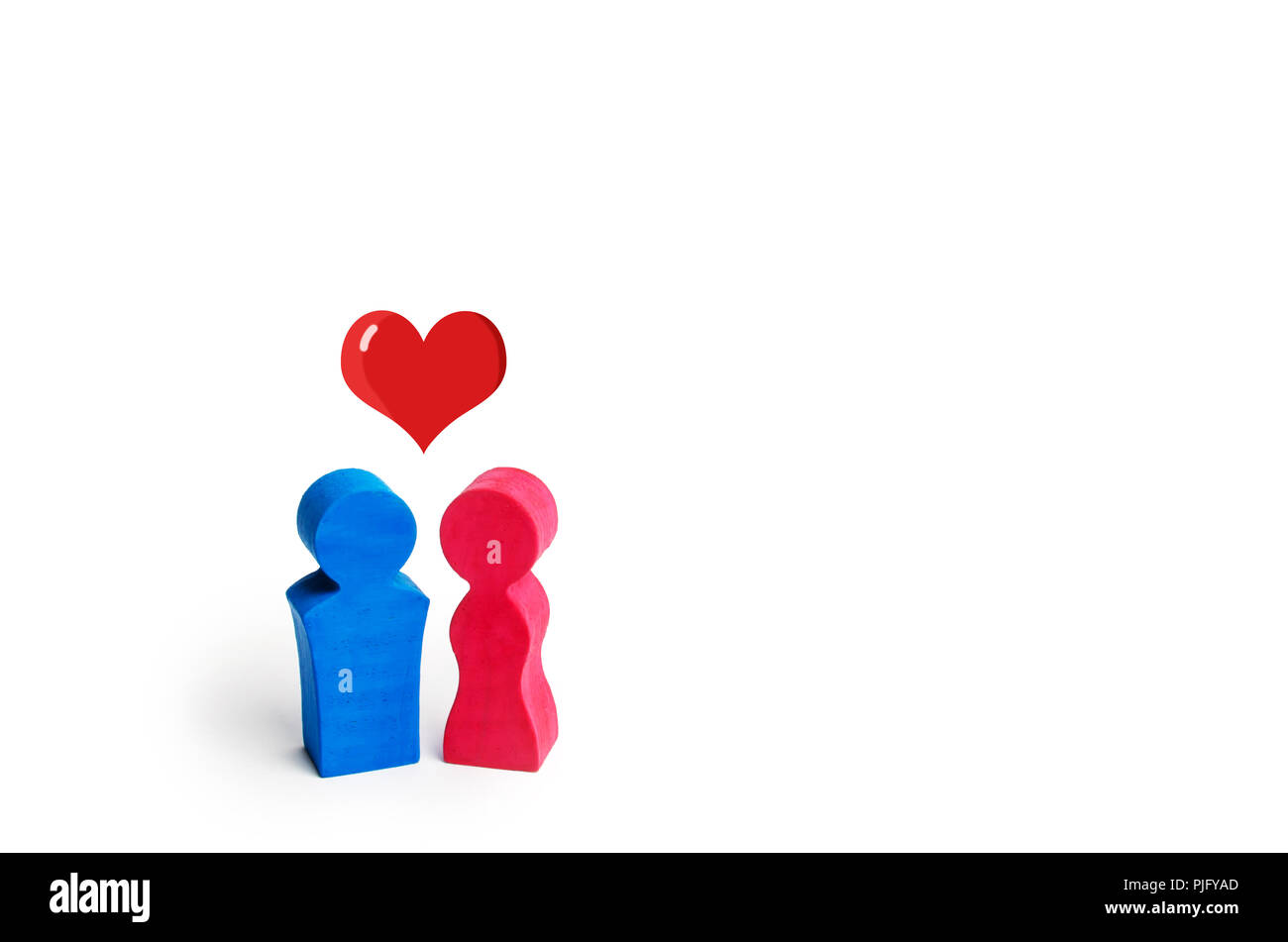 A man, a woman and a heart between them. The concept of love and sympathy between two people. Heterosexual relations. Conservative society. Human happ - Stock Image