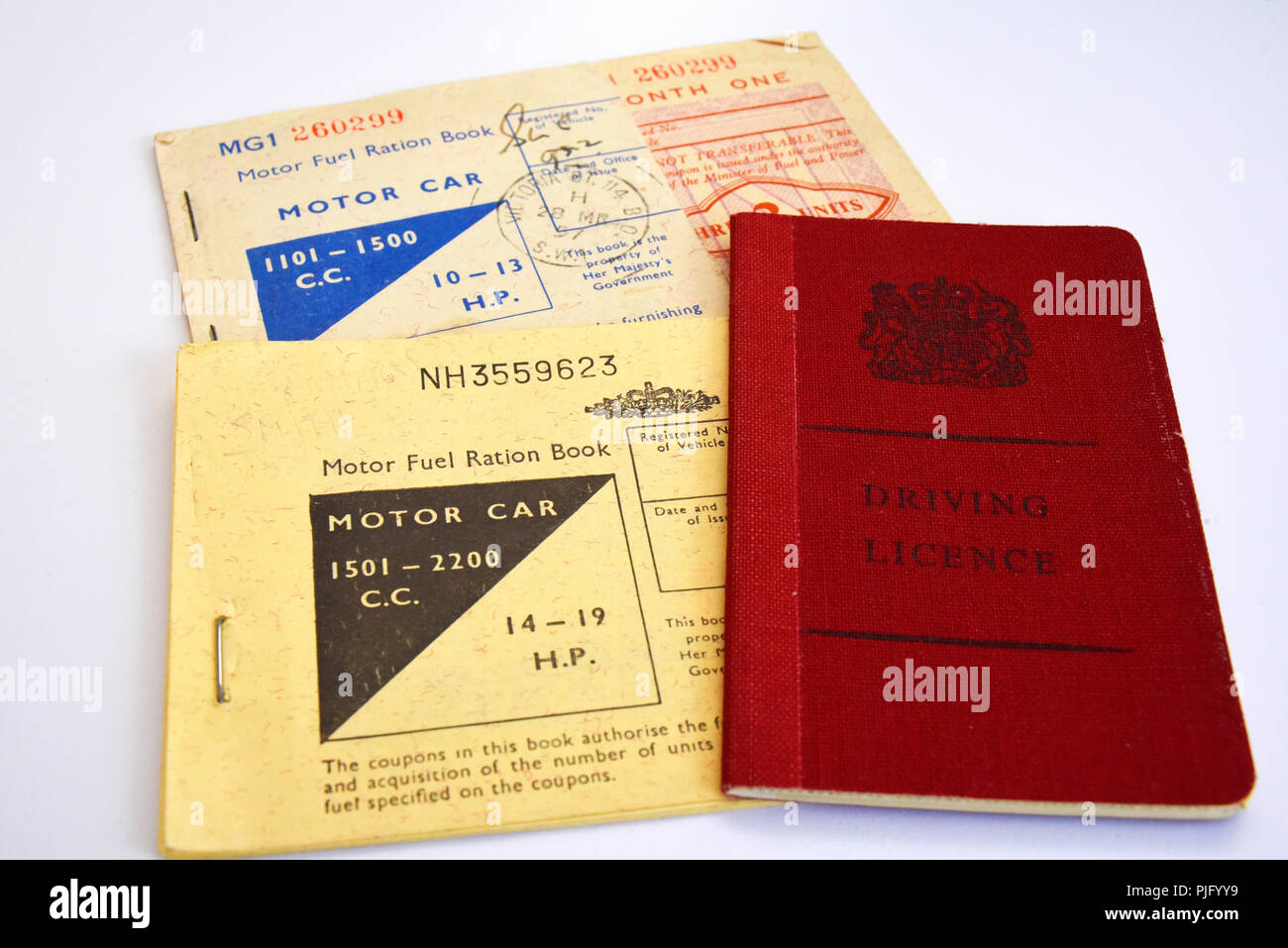 Motor fuel ration book. Petrol rationing. Fuel rations. Coupons for the purchase of motor car fuel, petrol, during post war rationing. Driving license Stock Photo