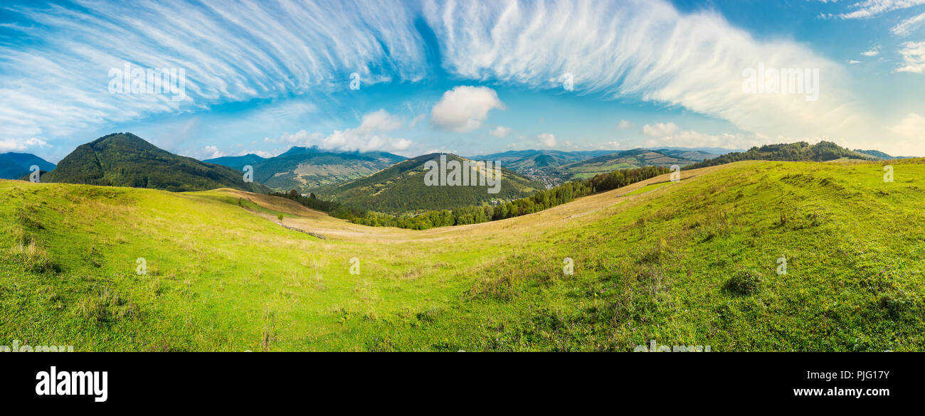 panorama of rural fields on curvy slopes. bright autumn day. lovely countryside on fine weather and gorgeous sky - Stock Image