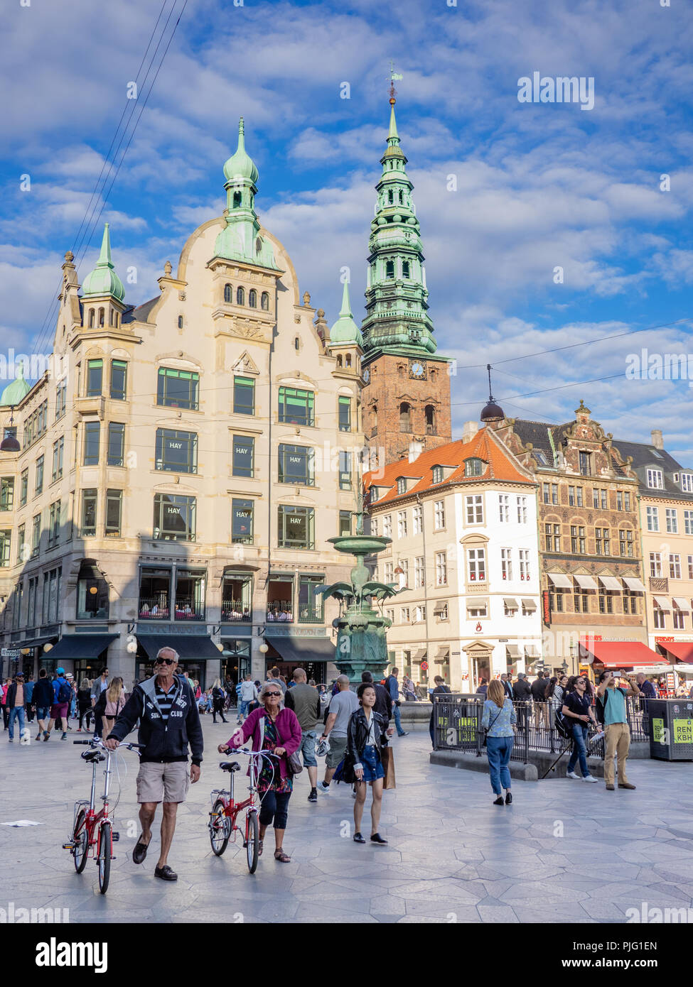 People walking through Amagertorv (English: Amager Square), a central square in the Strøget pedestrian zone in Copenhagen, Denmark. - Stock Image