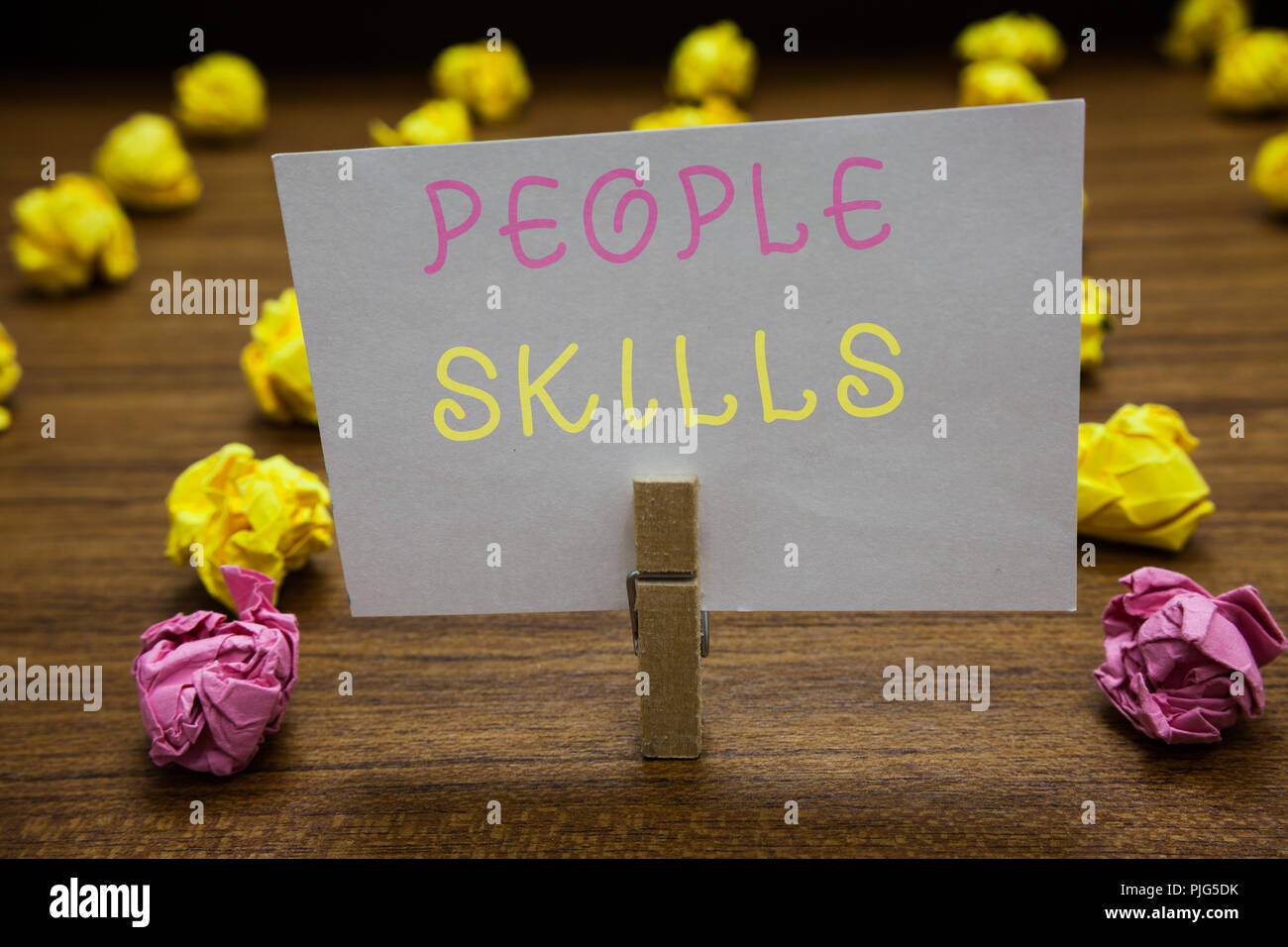 Handwriting text writing People Skills. Concept meaning Get Along well Effective Communication Rapport Approachable Clothespin holding white paper not - Stock Image