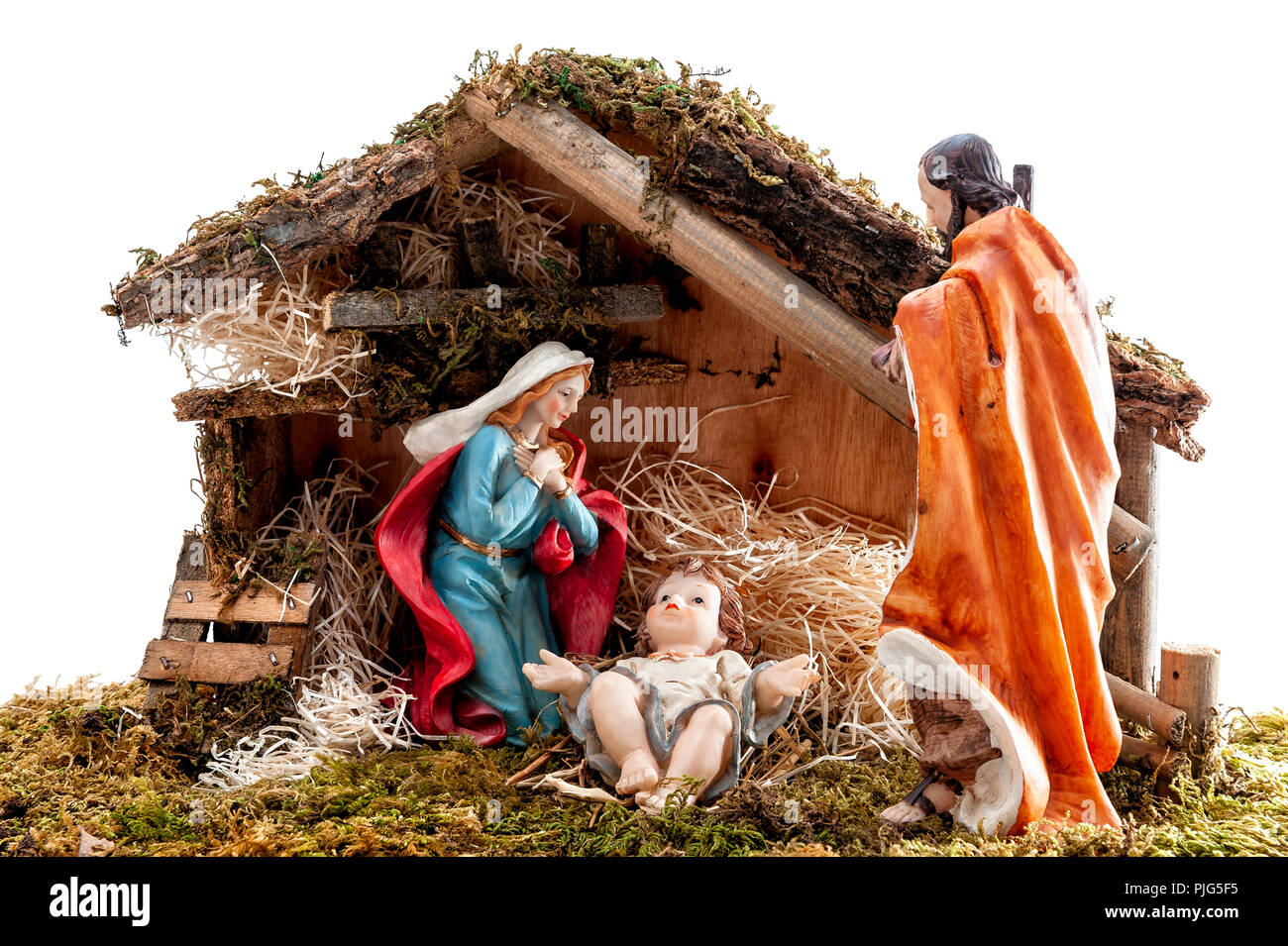 Christmas nativity scene. Hut with baby Jesus in the manger, with Mary and Joseph. Isolated on white background. Stock Photo