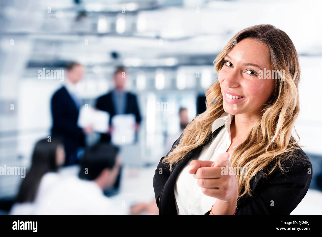 Businesswoman that indicates on the camera. Concept of people recruitment Stock Photo