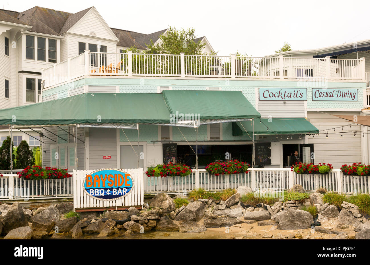 Casual dining, barbecue restaurant on the historic vacation town of Mackinac Island in Michigan. - Stock Image