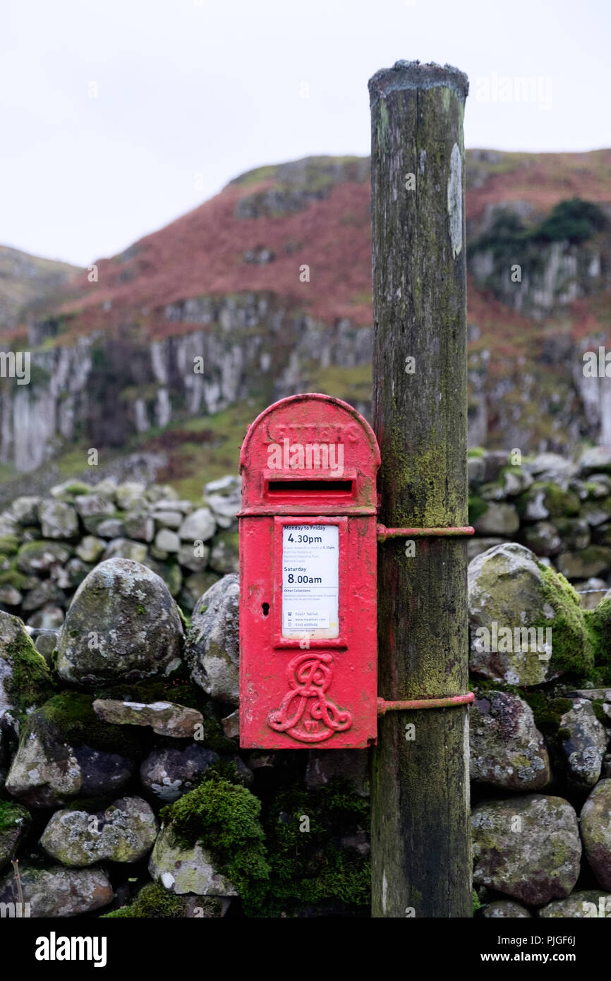 A bright red Edwardian post box with Edward VII royal cypher on a rural lane in Upper Teesdale, County Durham, England. - Stock Image