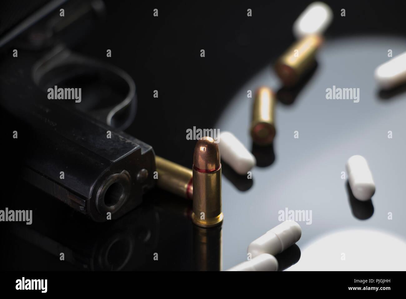 Gun, Bullets, and pills. School violence and antipsychotic drugs.School shootings, bullying and gun violence. American Issues. - Stock Image