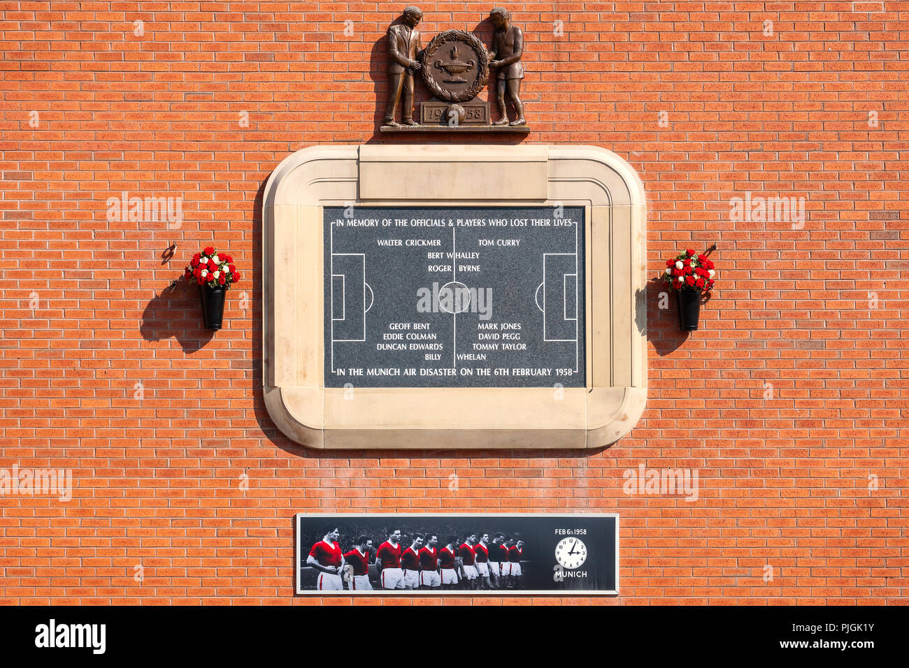 MANCHESTER, UK - MAY 19 2018: A plaque at Old Trafford in memory of the Munich air disaster in 1958 installed on the side og Old Trafforf stadium - Stock Image