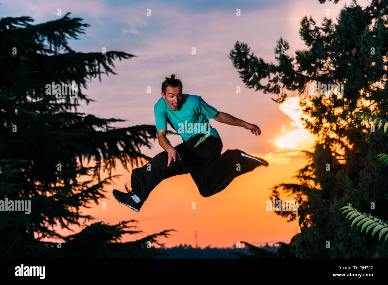 Parkour man is jumping and perform parkour sport - Stock Image