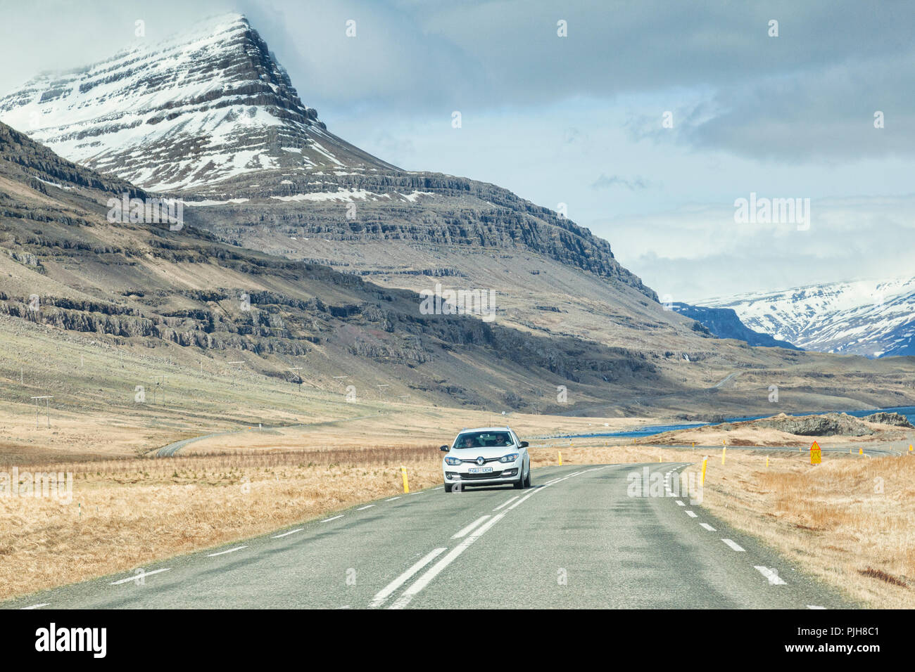 28 April 2018: South Iceland - Through the windscreen shot of the Iceland Ring Road in South Iceland, driving through snowy mountain scenery... Stock Photo