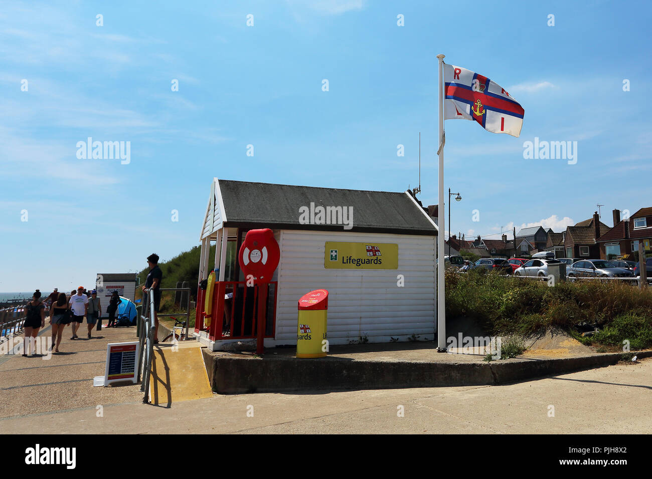 An RNLI lifeguards base in a beach hut on the promenade in Southwold, Suffolk, UK - Stock Image