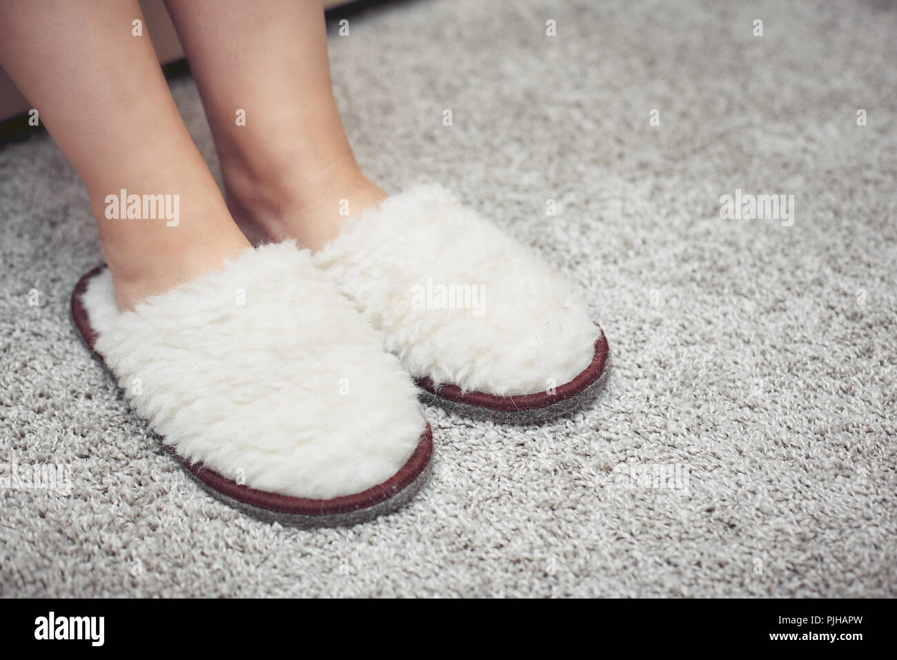 a7098147a8185 women's feet in fur Slippers on a warm carpet Stock Photo: 217969889 ...