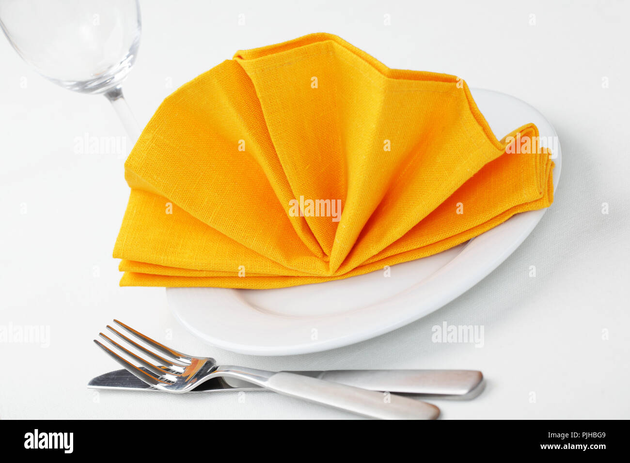 Table Setting With Napkin Folded As A Fan Stock Photo Alamy