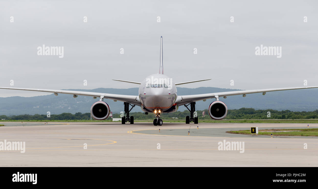 Russia, Vladivostok, 08/10/2018. Passenger airplane Airbus A330 of Aeroflot Airlines on airfield in cloudy day. Aviation and transportation. - Stock Image