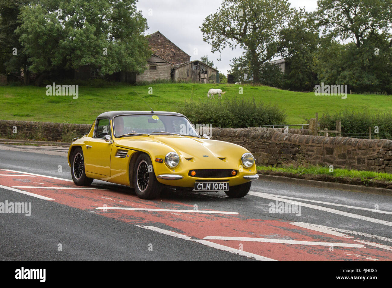 1969 yellow TVR Classic, vintage, veteran, cars of yesteryear, restored collectibles at Hoghton Tower Car Rally, UK - Stock Image