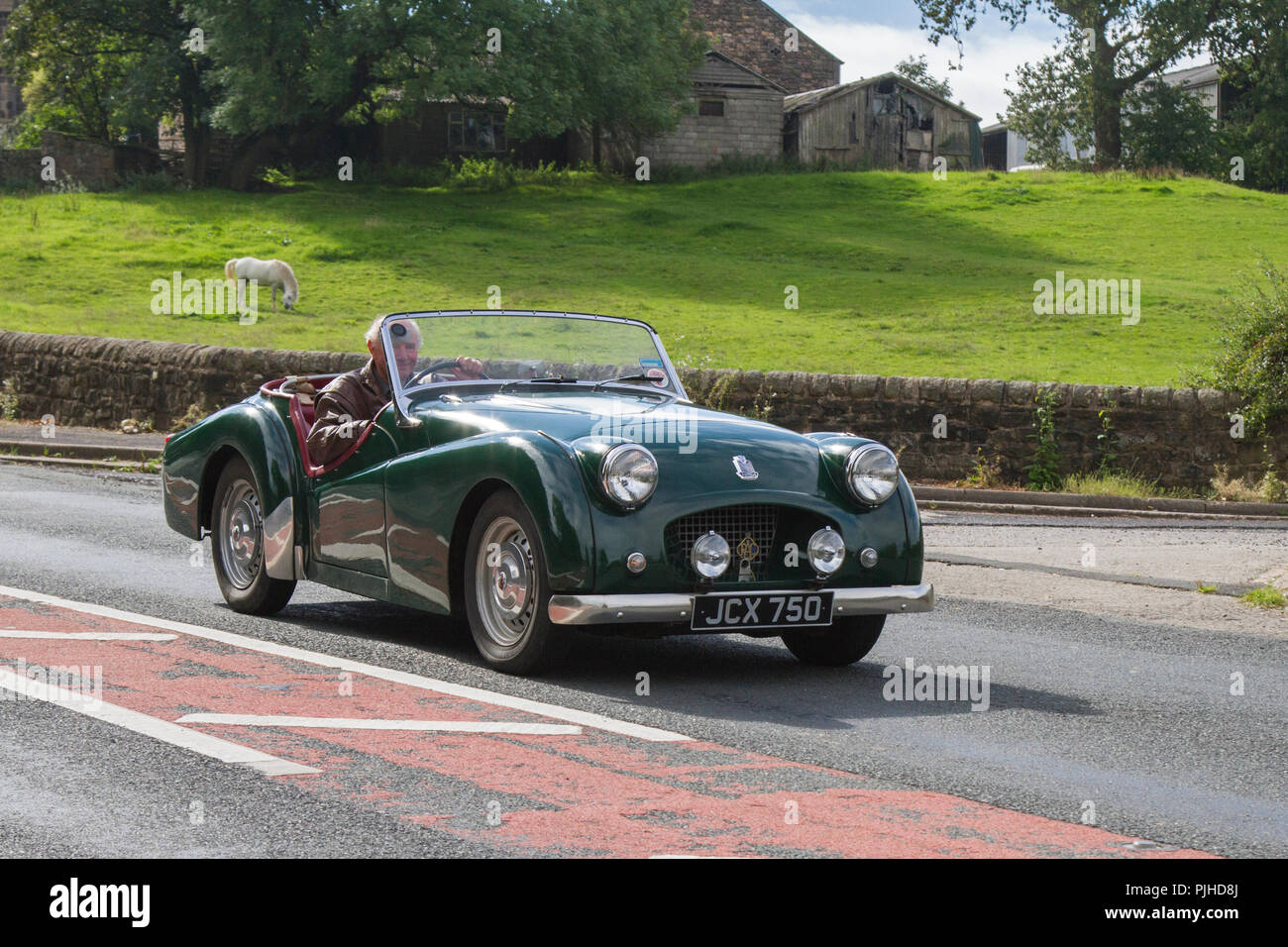 Triumph TR2 Classic, vintage, veteran, cars of yesteryear, restored collectibles at Hoghton Towers Car Rally, UK - Stock Image