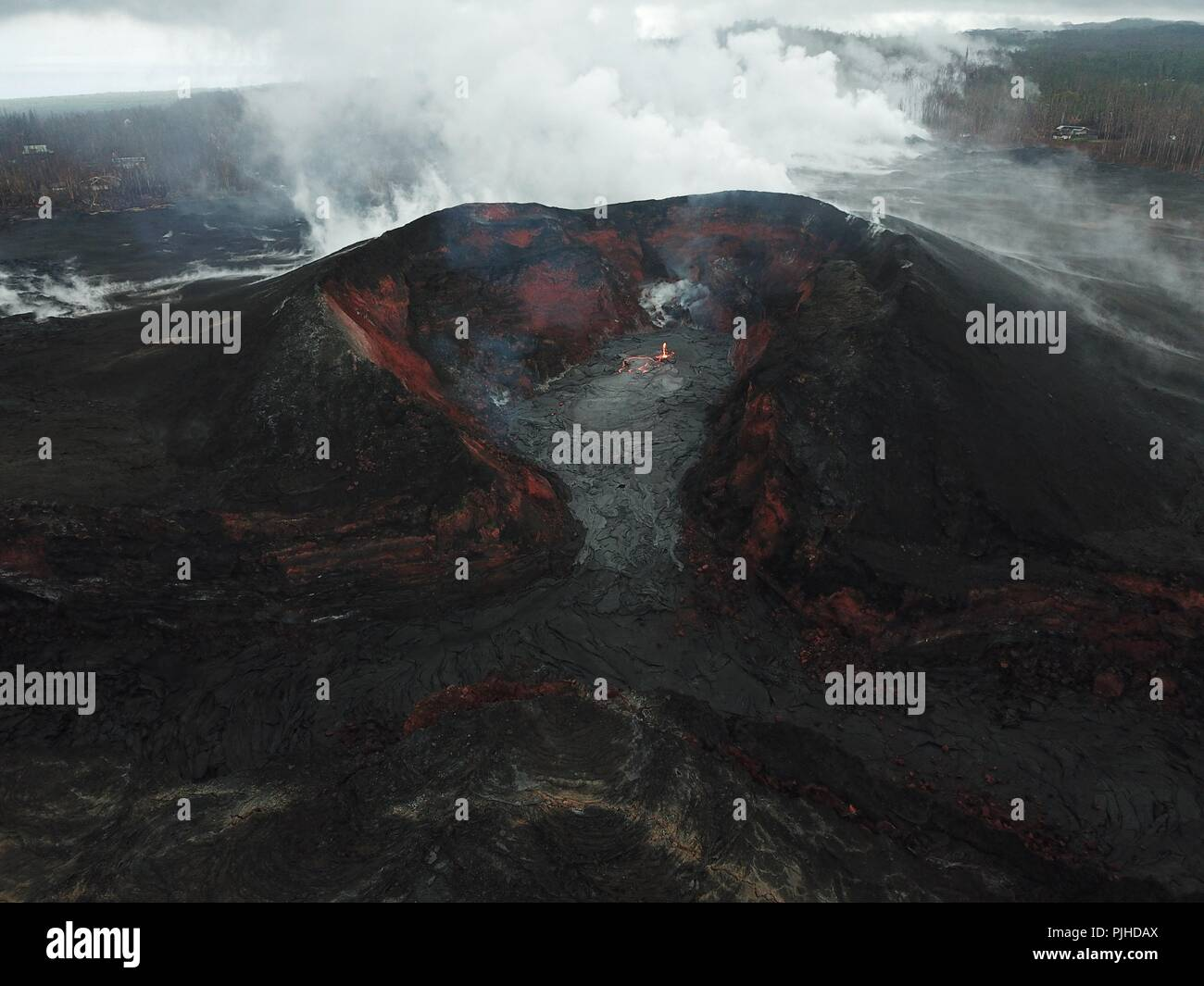 View using an Unmanned Aerial Vehicle into the fissure 8 lava cone in the Kilauea volcano showing a low level of activity September 6, 2018 in Hawaii. After three-months of continuous eruption the volcano has halted activity and appears to be over for the time being.Stock Photo