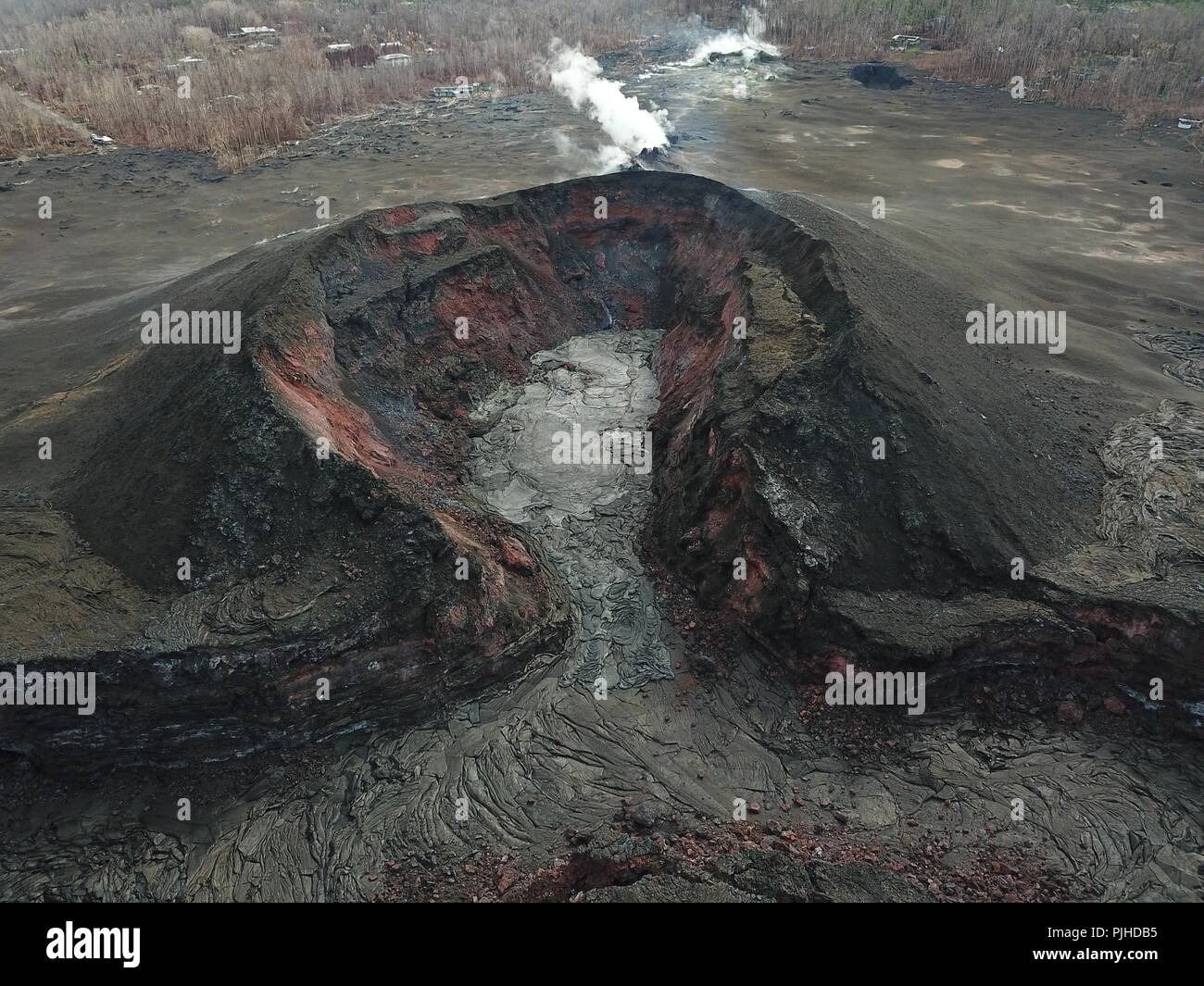 View using an Unmanned Aerial Vehicle into the fissure 8 lava cone in the Kilauea volcano showing a low level of activity September 2, 2018 in Hawaii. After three-months of continuous eruption the volcano has halted activity and appears to be over for the time being. - Stock Image