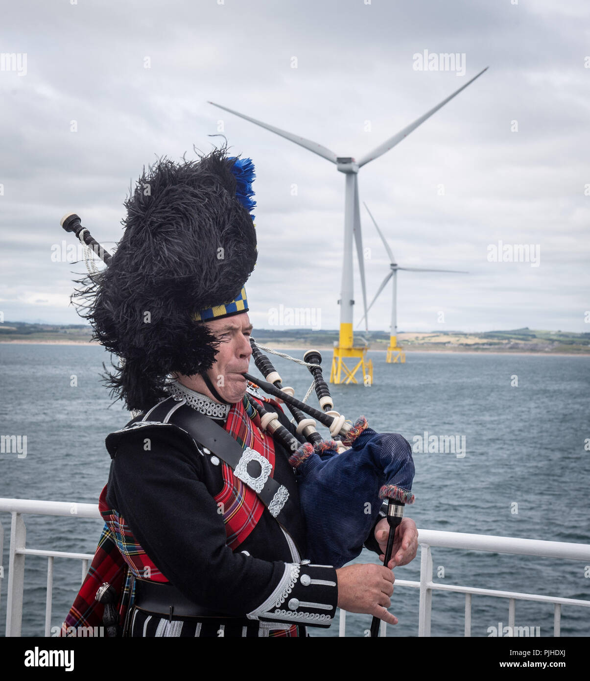 Piper Norman Fiddes at the opening of Vattenfall's European Offshore Wind Deployment Centre (EOWDC) off the coast of Aberdeen. - Stock Image