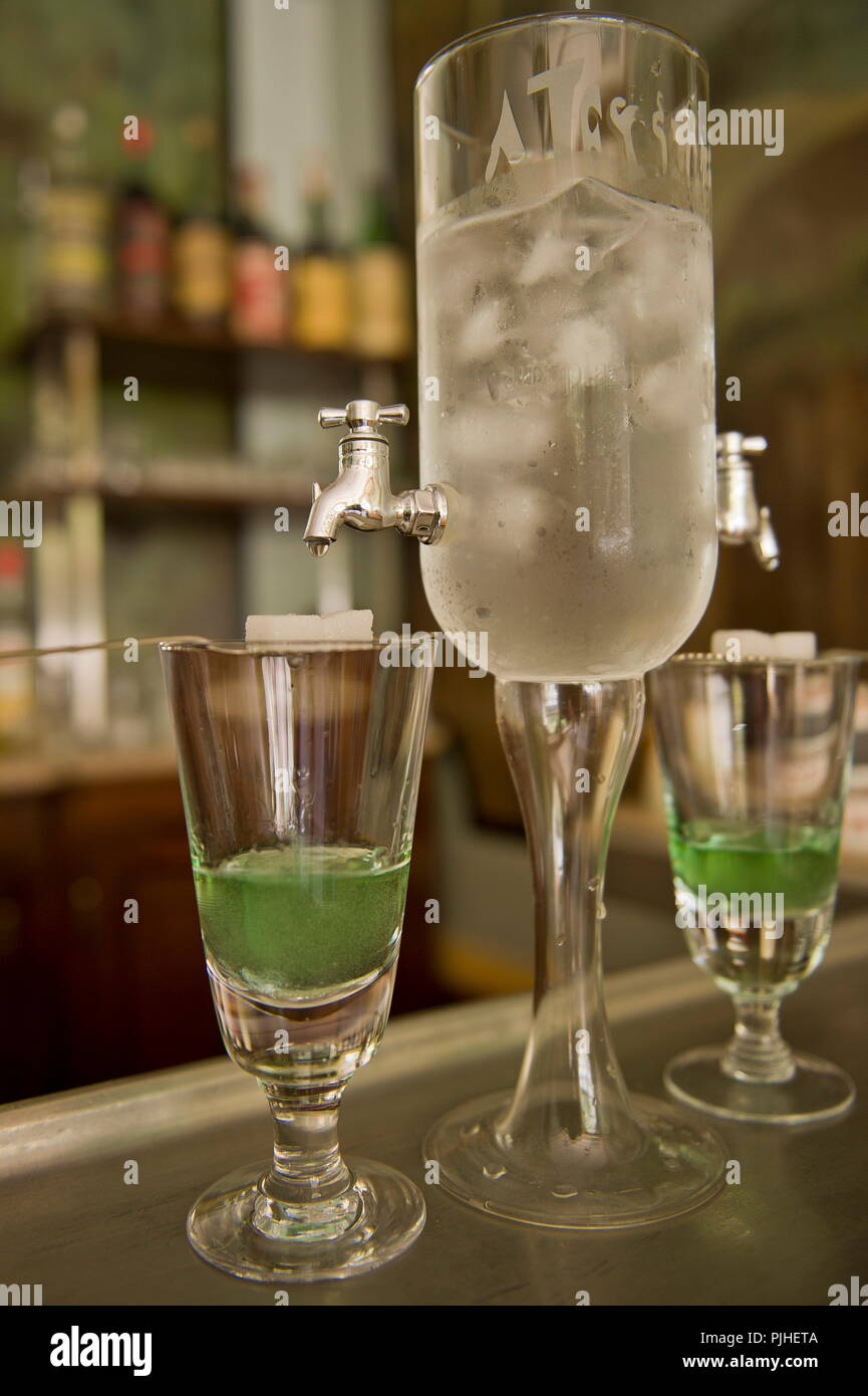 France, South-Western France, Cantal, Chaudes-Aigues, absinthe preparation at the Costeroste cafe in Chaudes-Aigues - Stock Image