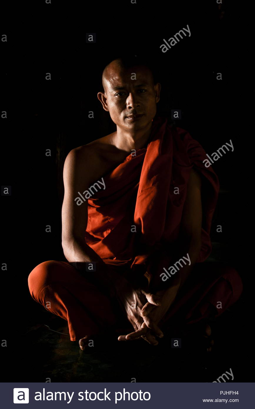 Myanmar Bagan Buddhist Monk Sitting And Meditating In A Temple Beautiful Light Shadow Effects