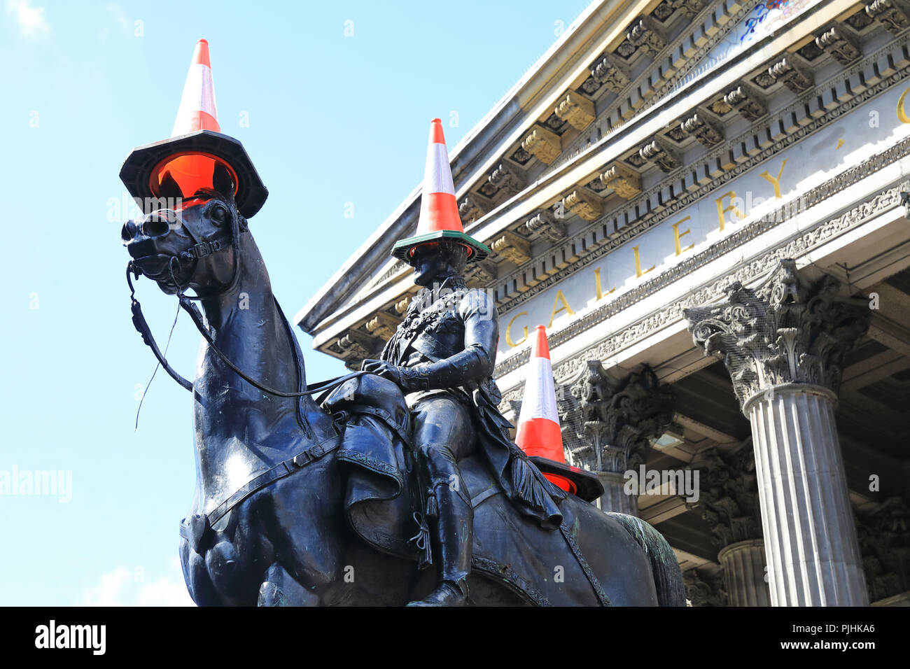 Traffic cones on the Duke of Wellington statue outside the Gallery of Modern Art, have come to represent the cultural identity of Glasgow in Scotlands - Stock Image