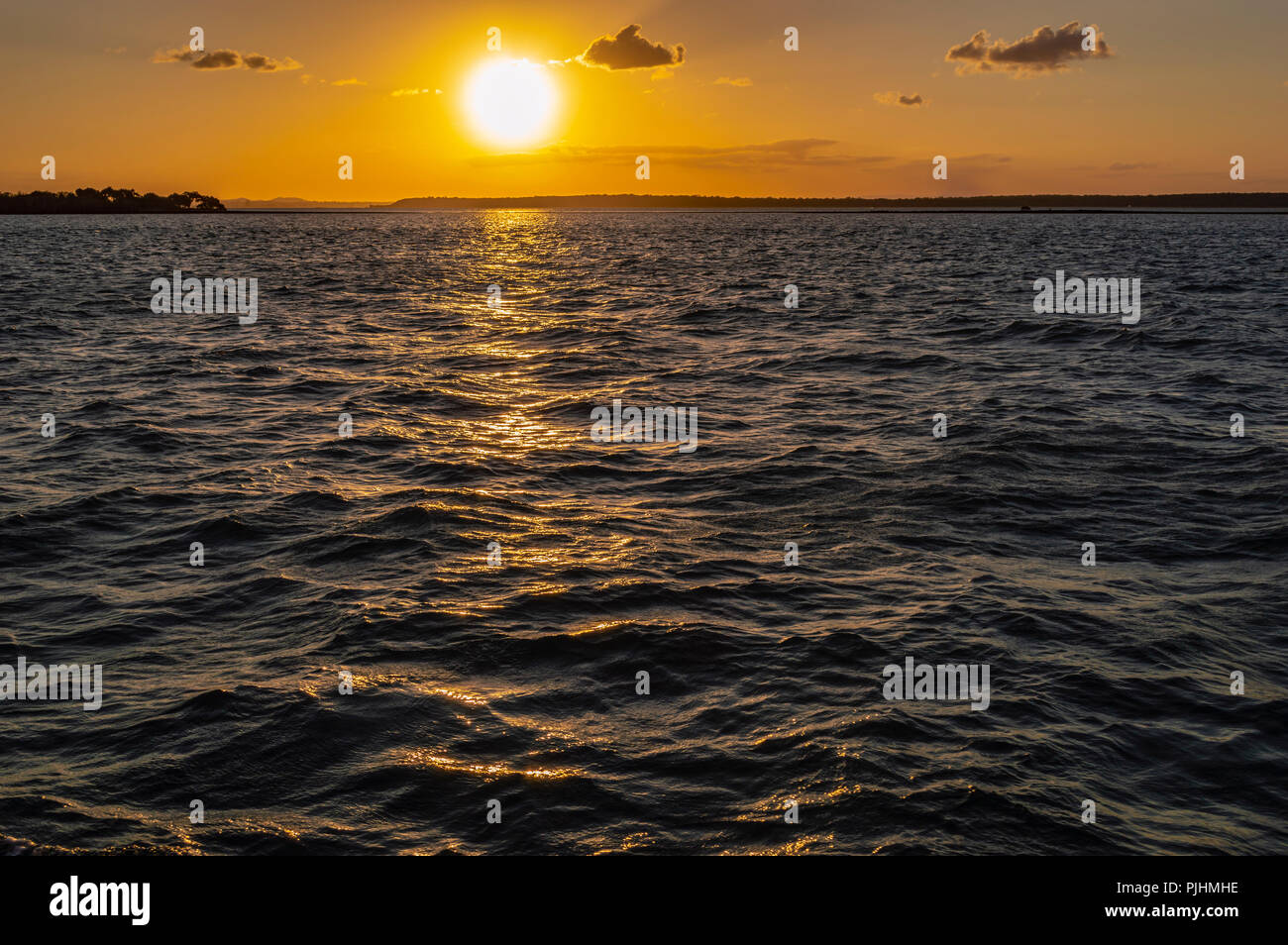 Sunset over Moreton Bay from the ferry to the mainland, Queensland, Australia Stock Photo
