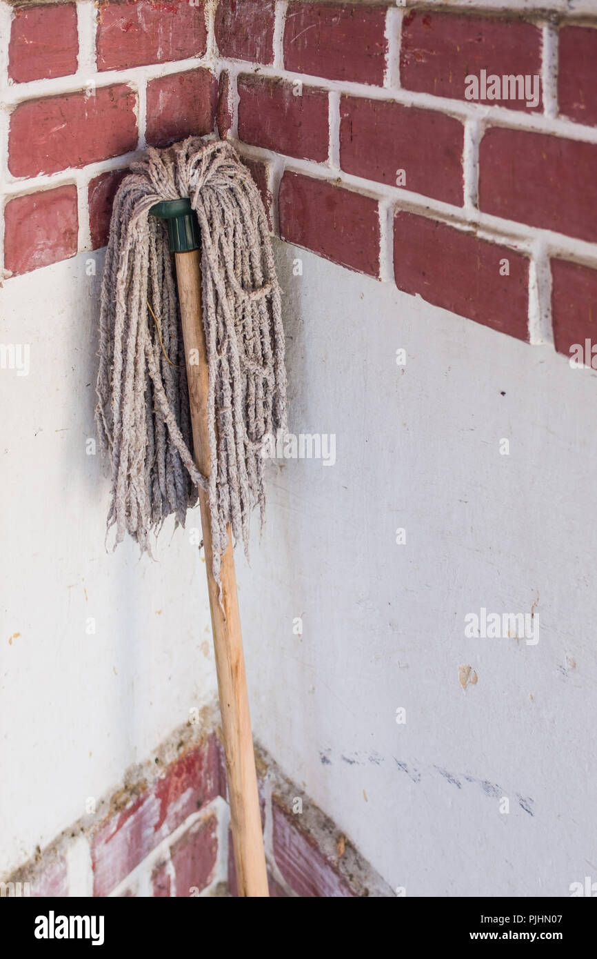 Still life with a drying mop. - Stock Image