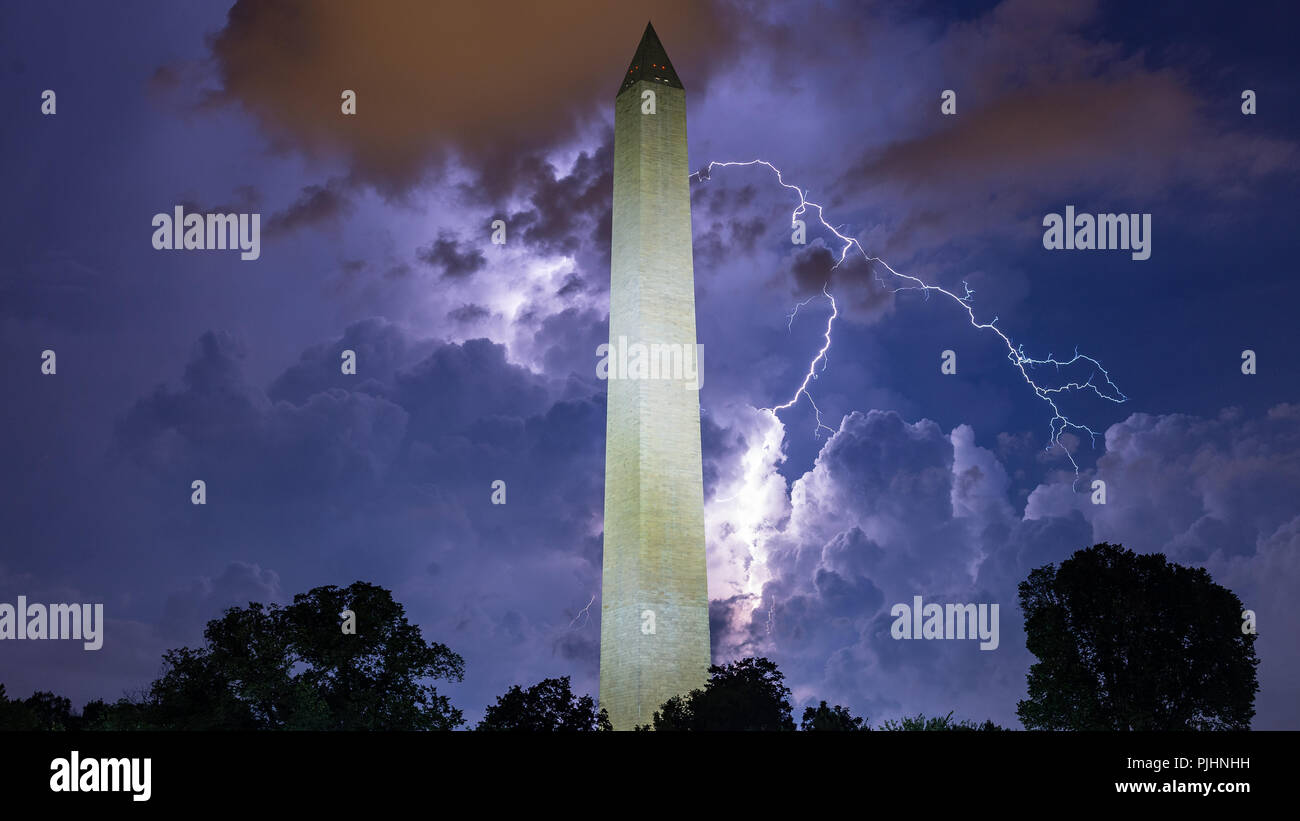 Lightning strikes over the Washington Monument in Washington, D.C., lighting up the storms clouds as thunderstorms passed through. Stock Photo