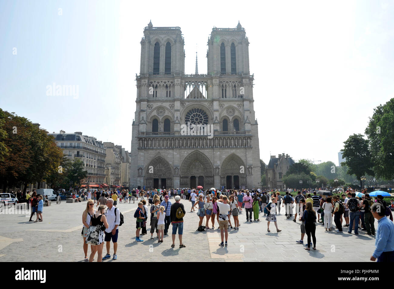 France, Paris city, Ile de la Cite, Notre-Dame cathedral, visitors to the square in front of the monument. - Stock Image