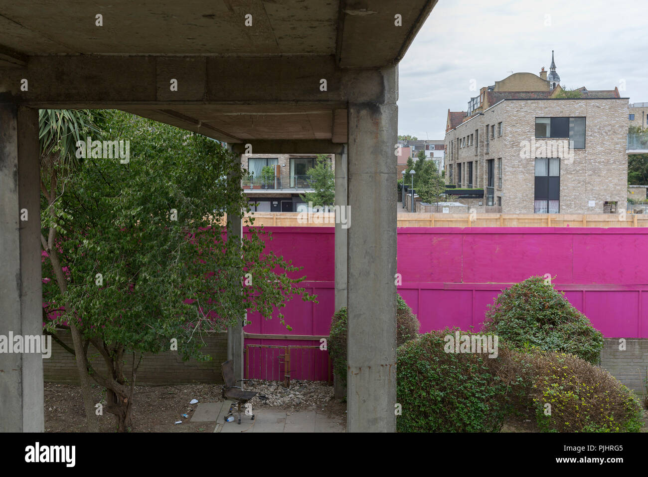 """An urban landscape on the soon-to-be demolished Aylesbury Estate, on 4th September 2018, in Southwark, London, England. The Aylesbury Estate contained 2,704 dwellings in approximately 7500 residents and built between 1963 and 1977 and for decades it was seen as a symbol of the failure of British social housing. There were major problems with the physical buildings on the estate and the poor perception of estates in Britain as a whole have led to the Aylesbury Estate gaining the title of """"one of the most notorious estates in the United Kingdom. Demolition is in progress for the regeneration of  Stock Photo"""