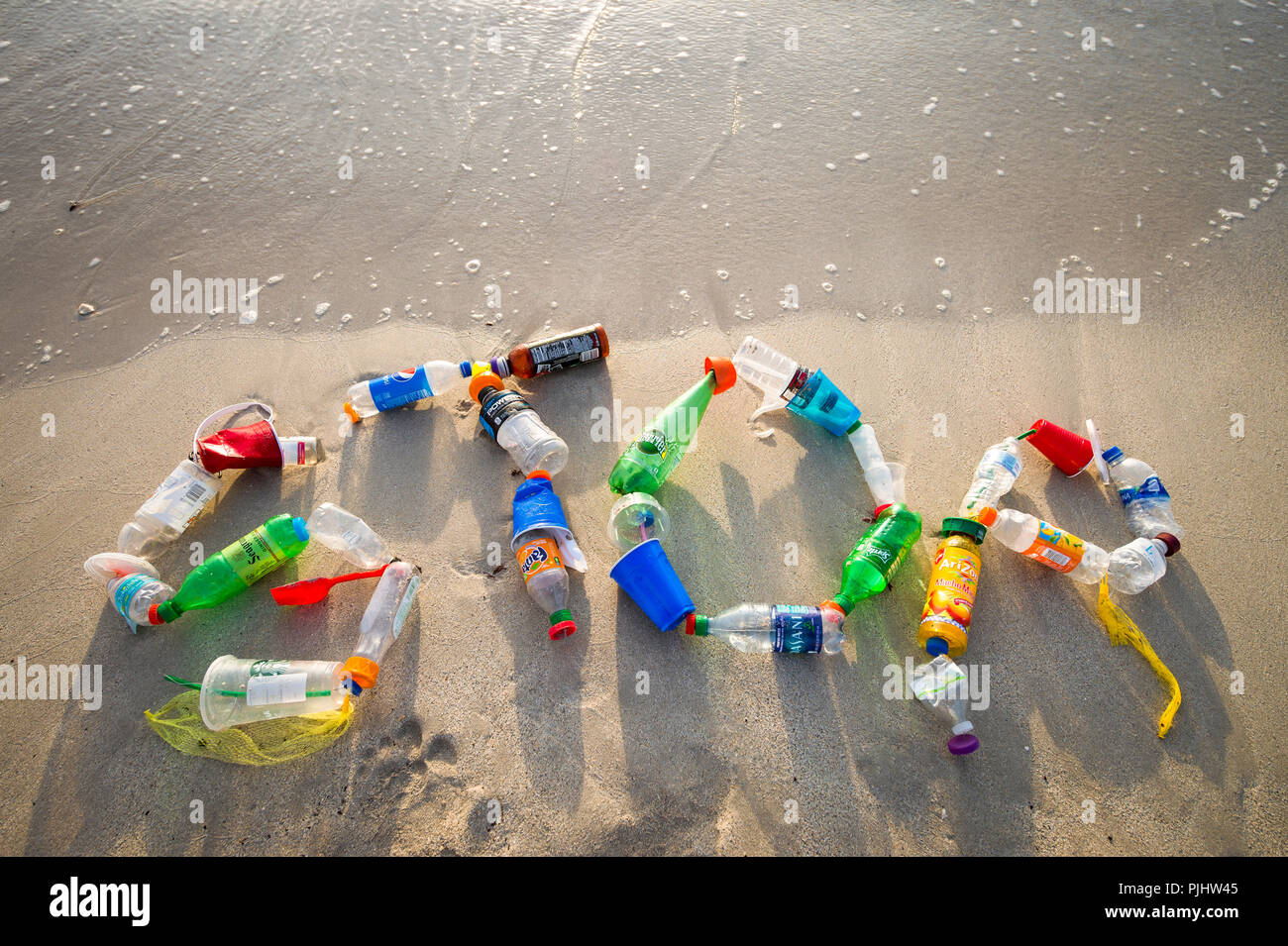 MIAMI - CIRCA JULY, 2018: 'STOP' spelled out in the sand using garbage collected on Miami beach and in the sea as a message for people to take action Stock Photo