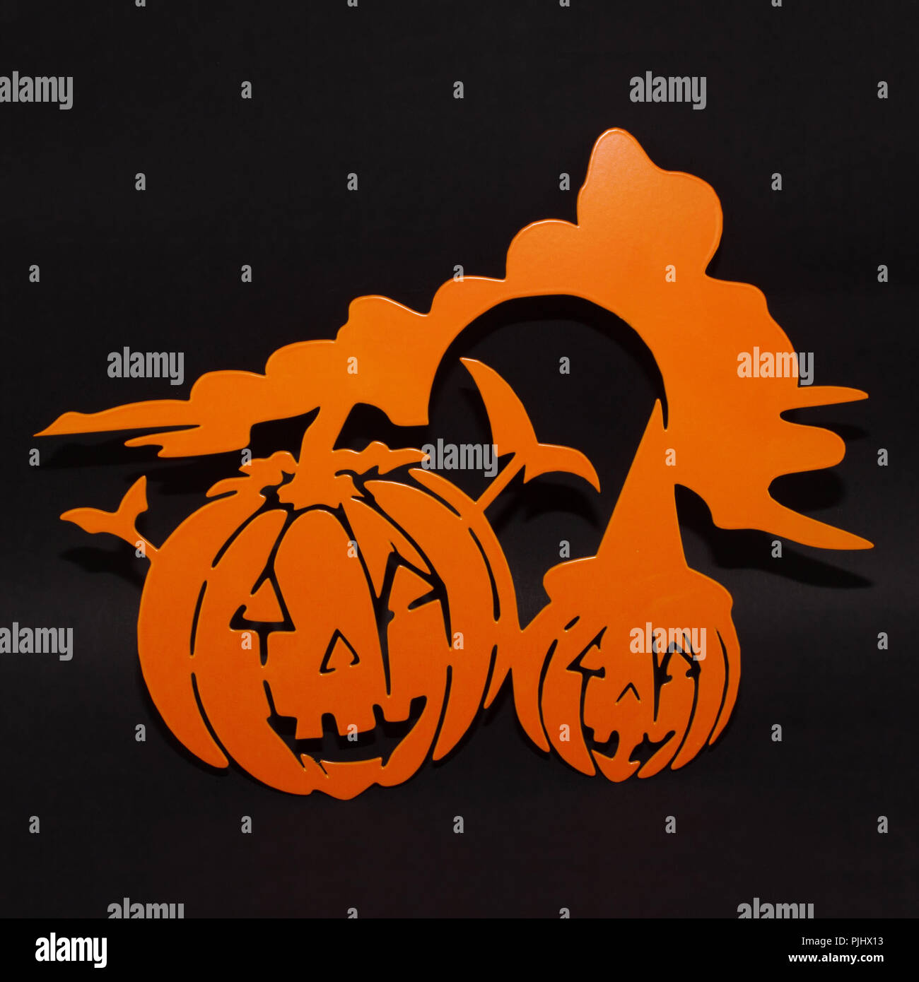 Halloween background decoration holiday concept. Two orange pumpkins angry faces shadow and silhouette on black background Stock Photo